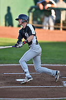 Taylor Snyder (4) of the Grand Junction Rockies follows through on his swing against the Ogden Raptors during the Pioneer League game at Lindquist Field on August 25, 2016 in Ogden, Utah. The Rockies defeated the Raptors 12-3. (Stephen Smith/Four Seam Images)
