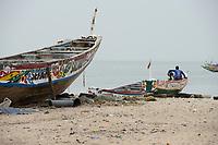 SENEGAL, Joal, coast fisherman, wooden boats at shore of atlantic ocean / Küstenfischer und Holzboote am Atlantik