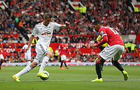 Pictured L-R: Gylfi Sigurdsson of Swansea against Chris Smalling of Manchester United. Saturday 16 August 2014<br />