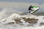 Pix: Shaun Flannery/shaunflanneryphotography.com...COPYRIGHT PICTURE>>SHAUN FLANNERY>01302-570814>>07778315553>>..4th December 2011…………..A rider powers a Kawasaki SX-R Jet Ski through a rough North Sea off the coast of Whitby in North Yorkshire, United Kingdom.