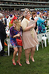 Royal Ascot horse racing Berkshire. 2012 Two young women, win winning happy, their horse has just won.