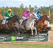 The final jump in the 2011 Colonial Cup: Tax Ruling, left, Here Comes Art, Divine Fortune.