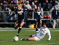 Alina Garciamendez (4) of Stanford tries to tackle the ball away from Adriana Leon (19) of Notre Dame during the final of the NCAA Women's College Cup at WakeMed Soccer Park in Cary, NC.  Notre Dame defeated Stanford, 1-0.