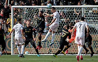 LOS ANGELES, CA - MARCH 01: Ben Sweat #22 of Inter Miami CF and Mark-Anthony Kaye #14 of LAFC battle in the box during a game between Inter Miami CF and Los Angeles FC at Banc of California Stadium on March 01, 2020 in Los Angeles, California.