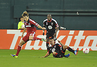Chris Rolfe (17) of the Chicago Fire goes against Perry Kitchen (23) of D.C. United.  The Chicago Fire defeated D.C. Untied 3-0, at RFK Stadium, Friday October 4 , 2013.