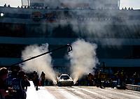 Oct 11, 2019; Concord, NC, USA; NHRA funny car driver J.R. Todd does a burnout during qualifying for the Carolina Nationals at zMax Dragway. Mandatory Credit: Mark J. Rebilas-USA TODAY Sports