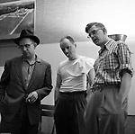 Pittsburgh PA: Brady Stewart Jr. discussing a photoshoot with two art directors at Brady Stewart Studio.