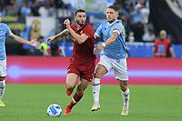 26th September 2021;  Stadio Olimpico, Rome, Italy; Italian Serie A football, SS Lazio versus AS Roma;Bryan Cristante of AS Roma gets past Ciro Immobile of SS Lazio
