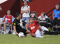FC Barcelona forward David Villa (7) gets tackle by Manchester United forward Danny Welbeck (19) Manchester United defeated Barcelona FC 2-1 at FedEx Field in Landover, MD Saturday July 30, 2011.
