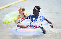 Malaki Stang, 11, (center) and Oakley Collins, 8, of Bella Vista (left) float, Saturday, July 31, 2021 at the lake at Horseshoe Bend Campground in Rogers. Check out nwaonline.com/210801Daily/ for today's photo gallery. <br /> (NWA Democrat-Gazette/Charlie Kaijo)
