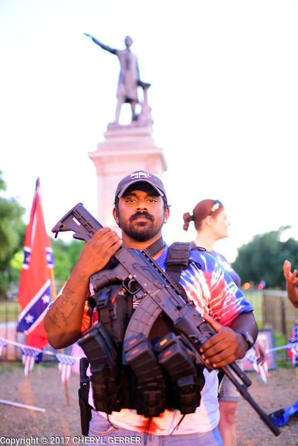 Protesters and counter-protesters clash over the removal of the Confederate Monuments at the Jefferson Davis monument, Monday night.