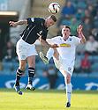 Dundee's Iain Davidson heads clear from Morton's Tony Wallace.