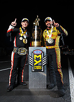Nov 11, 2018; Pomona, CA, USA; NHRA top fuel driver Steve Torrence (left) poses for a portrait with funny car winner J.R. Todd as he celebrates after winning the Auto Club Finals at Auto Club Raceway. Torrence swept all six of the countdown to the championship races to clinch the world championship. Mandatory Credit: Mark J. Rebilas-USA TODAY Sports