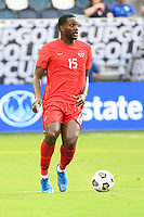 KANSAS CITY, KS - JULY 15: Doneil Henry #15 of Canada with the ball during a game between Canada and Haiti at Children's Mercy Park on July 15, 2021 in Kansas City, Kansas.