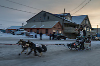 Richie Diehl runs down Front Street toward the finish line in Nome on Thursday March 19, 2015 during Iditarod 2015.  <br /> <br /> (C) Jeff Schultz/SchultzPhoto.com - ALL RIGHTS RESERVED<br />  DUPLICATION  PROHIBITED  WITHOUT  PERMISSION