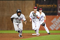 Auburn Doubledays shortstop Clayton Brandt (3) chases base runner Marcos Almonte (7) in a rundown as second baseman Dalton Dulin (1) backs up the play during a game against the Tri-City ValleyCats on August 25, 2016 at Falcon Park in Auburn, New York.  Tri-City defeated Auburn 4-3.  (Mike Janes/Four Seam Images)