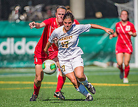 29 September 2013: University of Vermont Catamount Forward Nikki McFarland, a Freshman from Deer Park, NY, in action against the Stony Brook University Seawolves at Virtue Field in Burlington, Vermont. The Lady Cats fell to the visiting Seawolves 2-1 in America East play. Mandatory Credit: Ed Wolfstein Photo *** RAW (NEF) Image File Available ***