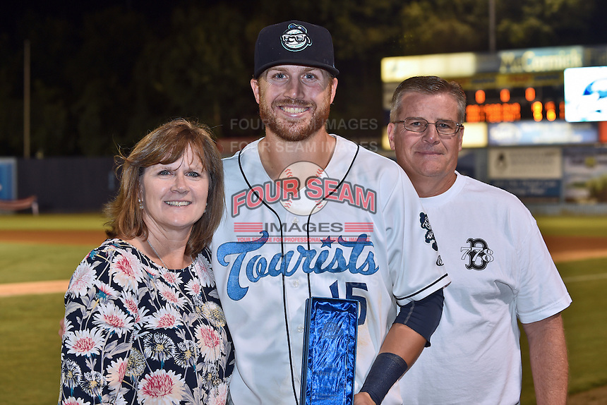 Asheville Tourists first baseman Brian Mundell (15) holds his league MVP award with his mother and father after a game against the Hagerstown Suns at McCormick Field on September 4, 2016 in Asheville, North Carolina. The Suns defeated the Tourists 10-5. (Tony Farlow/Four Seam Images)