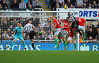Saturday 17 November 2012<br /> Pictured: Garry Monk of Swansea defending while Demba Ba of Newcastle heads the ball wide<br /> Re: Barclay's Premier League, Newcastle United v Swansea City FC at St James' Park, Newcastle Upon Tyne, UK.<br /> Steven Taylor (27)