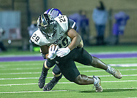 Devon Duhart (29) of  Little Rock Central  gets taken down by Fayetteville at Harmon Stadium, Fayetteville, Arkansas on Friday, November 13, 2020 / Special to NWA Democrat-Gazette/ David Beach
