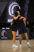 Silver Ferns Ameliaranne Ekenasio hugs Men's captain Kruze Tangiri before the Cadbury Netball Series final between NZ Silver Ferns and NZ Men at the Fly Palmy Arena in Palmerston North, New Zealand on Saturday, 24 October 2020. Photo: Dave Lintott / lintottphoto.co.nz