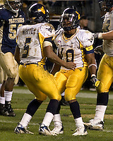 16 November 2006: WVU running back Steve Slaton (10) and quarterback Pat White (5)..The West Virginia Mountaineers defeated the Pitt Panthers 45-27 on November 16.