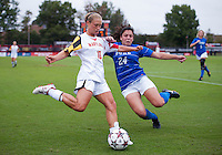 Riley Barger (10) of Maryland crosses the ball in front of Mollie Pathman (24) of Duke at Ludwig Field on the campus of the University of Maryland in College Park, MD. DC. Duke defeated Maryland, 2-1.