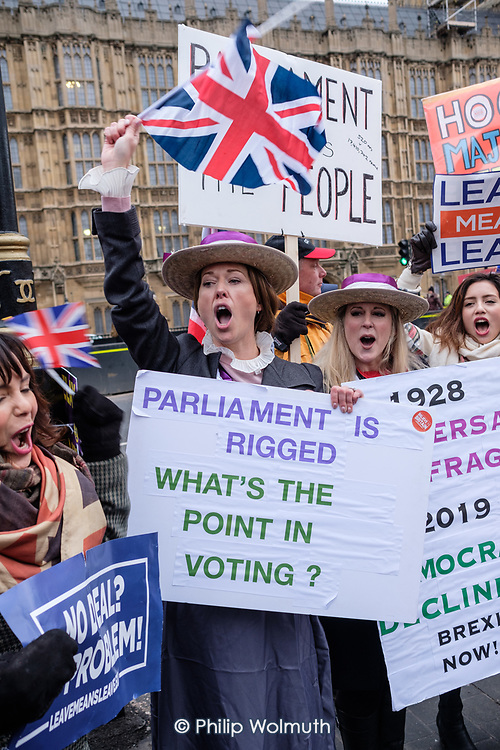 Brexit supporters dressed as Suffragettes demonstrate outside the Houses of Parliament as MPs vote on amendments to Theresa May's withdrawal deal with the EU.  Westminster, London.