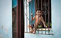 27/07/18<br /> <br /> A boy sits on windowsill of house. Trinidad, Cuba.<br /> <br /> All Rights Reserved, F Stop Press Ltd. (0)1335 344240 +44 (0)7765 242650  www.fstoppress.com rod@fstoppress.com