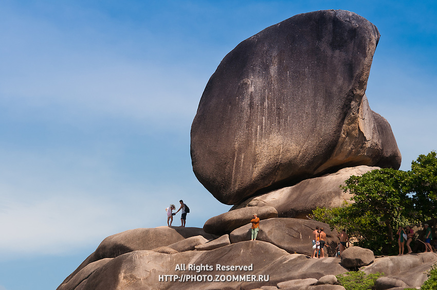 People climbing to the Sail rock on Similan islands in Thailand