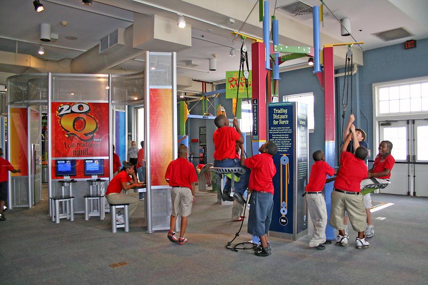 Mixed ethnic children interactive exhibit Gulf Coast Exploreum Science Center Mobile Alabama