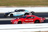May 7, 2017; Commerce, GA, USA; NHRA pro stock driver Erica Enders-Stevens (near) races alongside Tanner Gray during the Southern Nationals at Atlanta Dragway. Mandatory Credit: Mark J. Rebilas-USA TODAY Sports