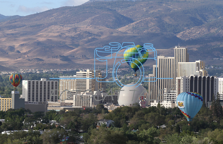 Hot air balloons fly above downtown Reno, Nev., on media day of the Great Reno Balloon Race on Sept. 9, 2010..Photo by Cathleen Allison
