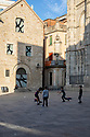 Spain - Barcelona - Children playing football in the square of the Gothic Cathedral usually filled with tourists.