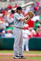 AJ Schugel (14) of the Arkansas Travelers stands on the mound during a game against the Springfield Cardinals at Hammons Field on May 8, 2012 in Springfield, Missouri. (David Welker/ Four Seam Images).