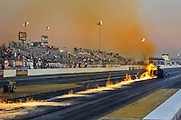 Oct. 14, 2011; Chandler, AZ, USA; NHRA top fuel dragster driver Cory McClenathan leaves a trail of fire on the track after breaking a fuel line during qualifying for the Arizona Nationals at Firebird International Raceway. Mandatory Credit: Mark J. Rebilas-