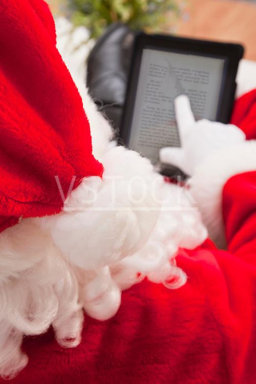 USA, Illinois, Metamora, Close-up of Santa Claus using digital tablet