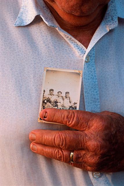 Angelo Catalano Holding a Photograph of Himself as a Young Man (l) with Bill and Mario Musuneci, Catalano's Farm, Mareeba, 2002.