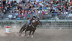 Barrell racing action at the Smackdown Tour Bull Riding event at Fuji Park in Carson City, Nev., on Saturday, June 7, 2014.<br /> Photo by Cathleen Allison