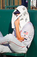 Hagerstown Suns relief pitcher Jake Walsh (35) covers up in the bullpen prior to the game against the Greensboro Grasshoppers at NewBridge Bank Park on June 21, 2014 in Greensboro, North Carolina.  The Grasshoppers defeated the Suns 8-4. (Brian Westerholt/Four Seam Images)