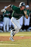 Shortstop Daniel Fickas (26) of the University of South Carolina Upstate Spartans runs out a grounder in a game against the Citadel Bulldogs on Tuesday, February, 18, 2014, at Cleveland S. Harley Park in Spartanburg, South Carolina. Upstate won, 6-2. (Tom Priddy/Four Seam Images)