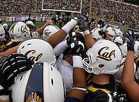 CAL players huddle together before going back to the locker room before the game against Nevada at Memorial Stadium in Berkeley, California on September 1st, 2012.  Nevada Wolf Pack defeated California, 31-24.