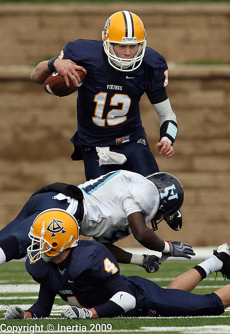 SIOUX FALLS, SD - 17: Luke Butler #12 of Augustana looks to leap over defender DaeJohn Love #41 of Upper Iowa in the second quarter of their game Saturday afternoon at Augustana College. (Photo by Dave Eggen/Inertia)