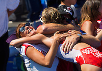 24 JUL 2014 - GLASGOW, GBR - Kirsten Sweetland (CAN) from Canada celebrates winning the silver medal at the elite women's 2014 Commonwealth Games triathlon in Strathclyde Country Park, in Glasgow, Scotland with supporters (PHOTO COPYRIGHT © 2014 NIGEL FARROW, ALL RIGHTS RESERVED)<br /> *******************************<br /> COMMONWEALTH GAMES <br /> FEDERATION USAGE <br /> RULES APPLY<br /> *******************************