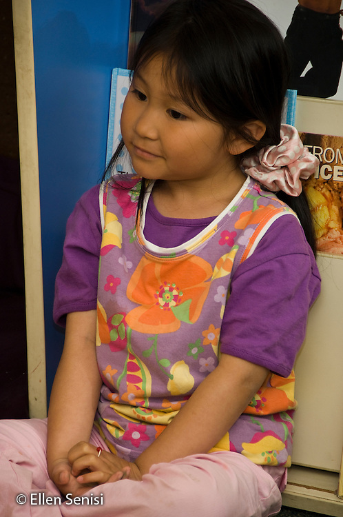 MR / College Park, Maryland.Center for Young Children, laboratory school within the College of Education at the University of Maryland. Full day developmental program of early childhood education for children of faculty, staff, and students at the university..Student (girl, 5, Asian American) listens during class..MR: Pha1.© Ellen B. Senisi