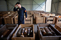 Gino Lambrecht, a member of the Belgian Unexploded Ordnance Disposal Group, oversees a large collection of unexploded munitions from WW1. So much ordnance is dug up by farmers when they plough their fields that their is a twice-a-day controlled explosion to destroy it.