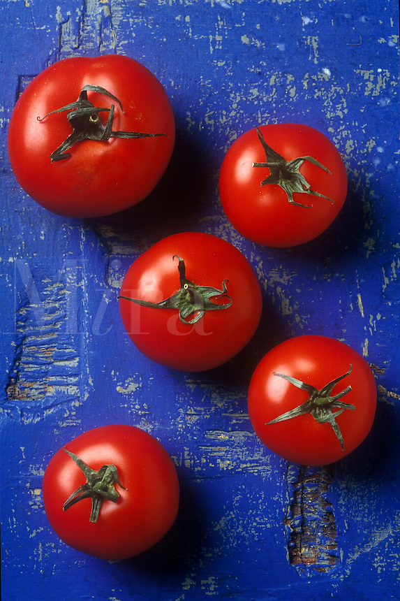 Red tomatoes on blue table..