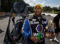 May 11, 2013; Commerce, GA, USA: NHRA top fuel dragster driver Antron Brown celebrates after winning the Southern Nationals at Atlanta Dragway. Mandatory Credit: Mark J. Rebilas-