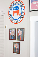 Photos of US President Donald Trump, Vice President Mike Pence, and New Hampshire governor Chris Sununu hang on a wall in the office of the New Hampshire Republican State Committee in Concord, New Hampshire, on Wed., Sept. 16, 2020.