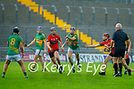 Referee Mike Sexton keeps an eye on Lixnaws Tom Foley as Ballyheigues Michael Leane and Rickey Hussey attempts to slow down his clearance in Round 2 of the County Senior Hurling championship,